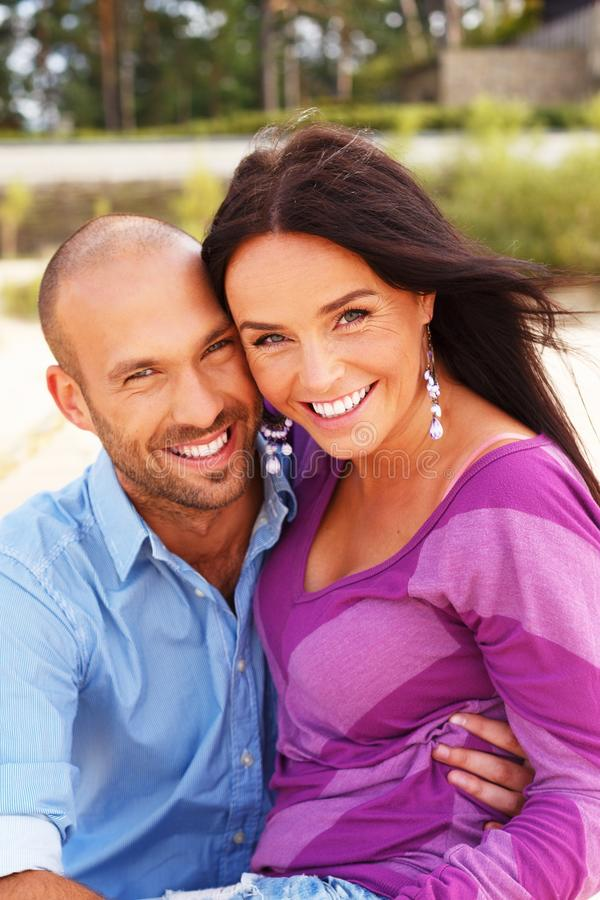 Middle-aged couple on a beach stock images