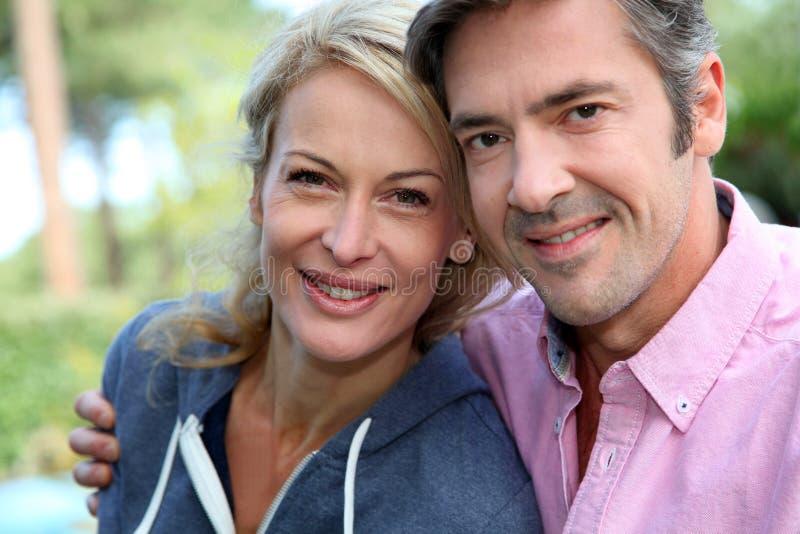 Middle-aged couple enjoying outdoors royalty free stock image