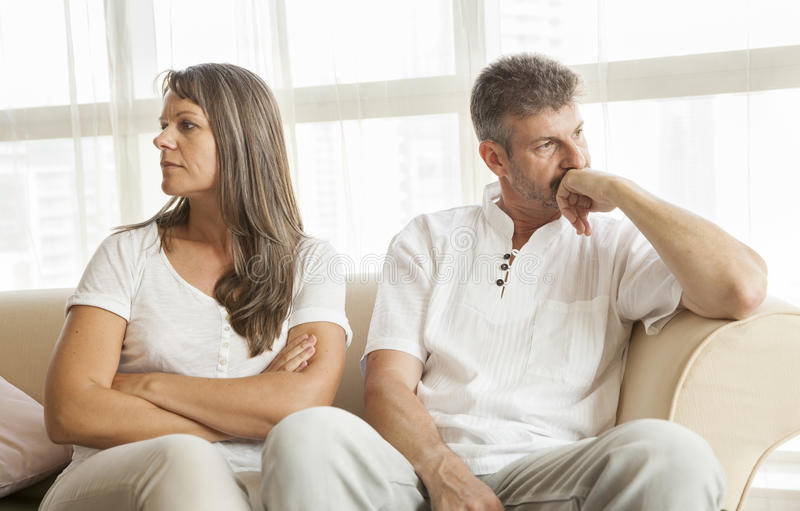 Middle aged couple fighting stock images