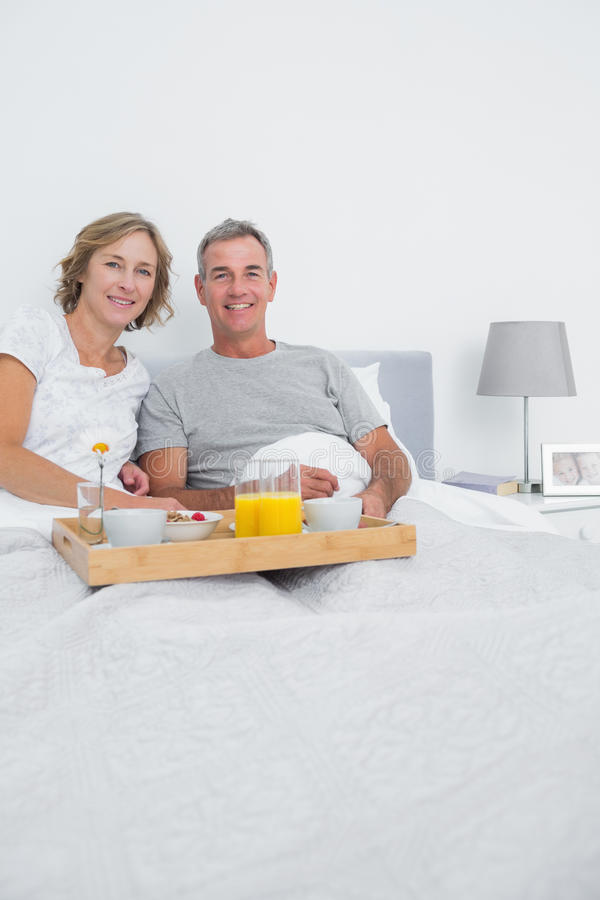 Middle Aged Couple Having Breakfast In Bed Together Royalty Free Stock Photography
