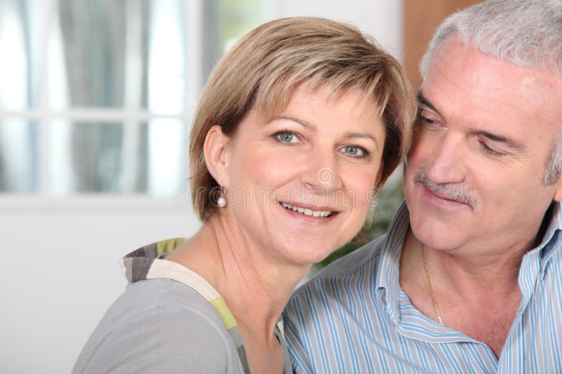 Middle-aged couple at home royalty free stock photos