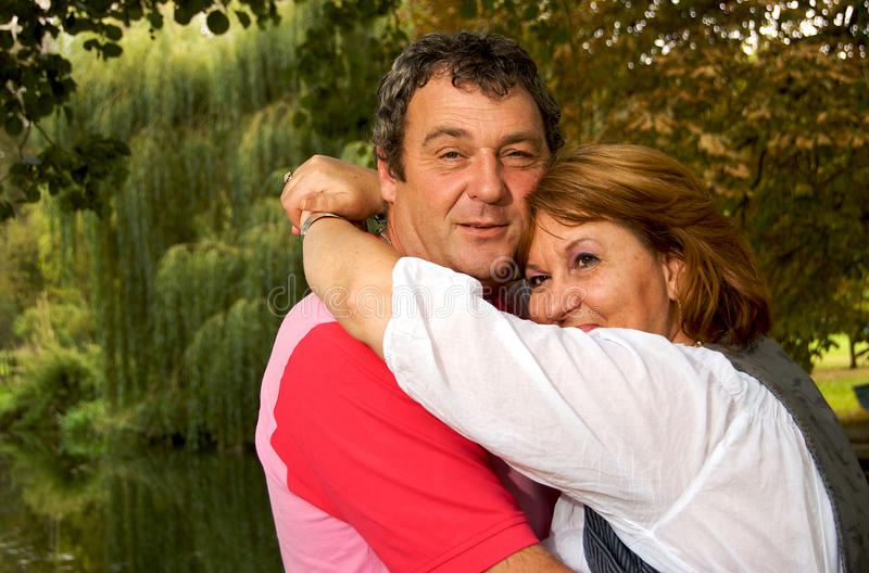 Middle Aged Couple Hugging Stock Photography
