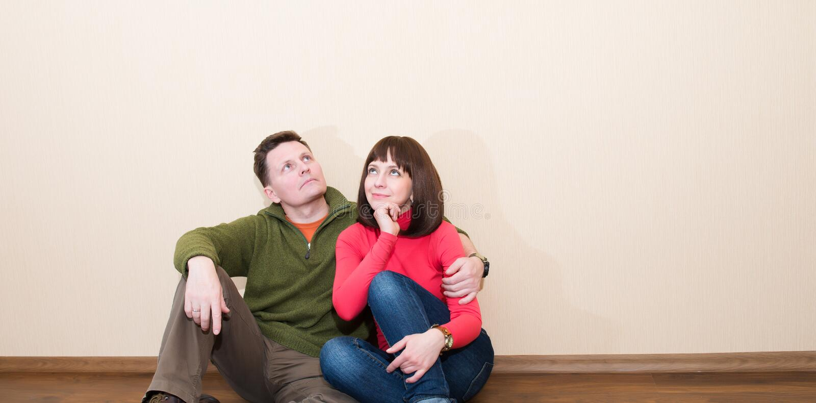 Middle aged couple in the new flat. Embracing man and woman at n stock photo
