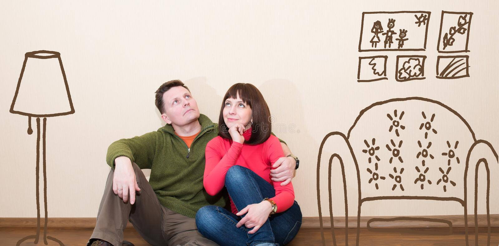 Middle aged couple in the new flat. Embracing man and woman at n stock image