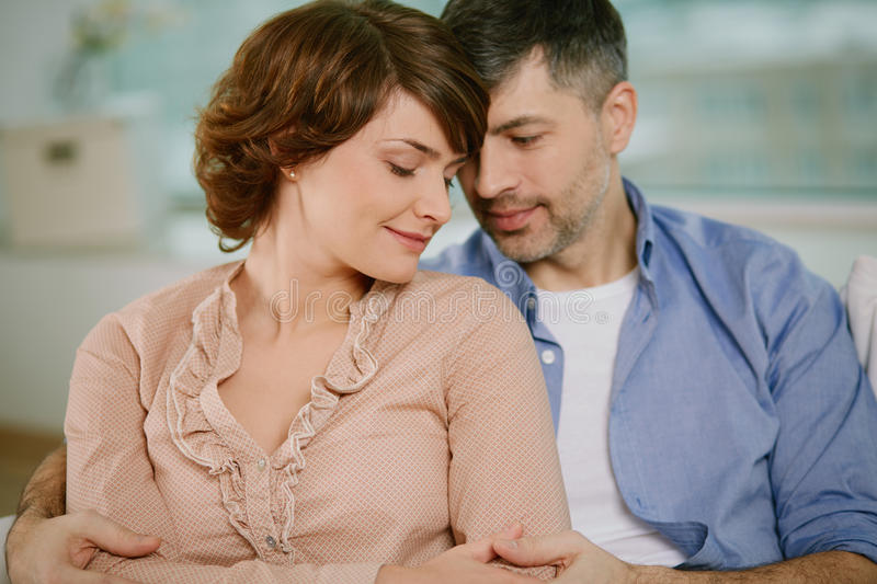 Middle aged couple. Portrait of tender couple enjoying being together royalty free stock photography