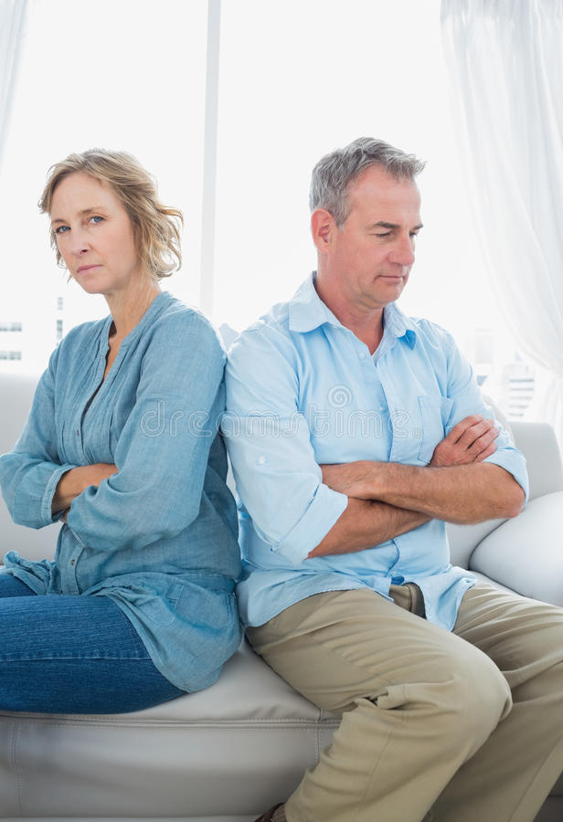 Download Middle Aged Couple Sitting On The Sofa Not Speaking After A Figh Stock Photo - Image: 32514944