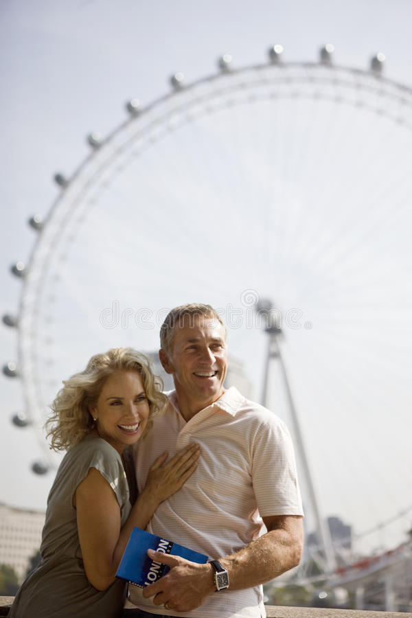Download A Middle-aged Couple Standing In Front Of The London Eye Editorial Photography - Image: 67263272