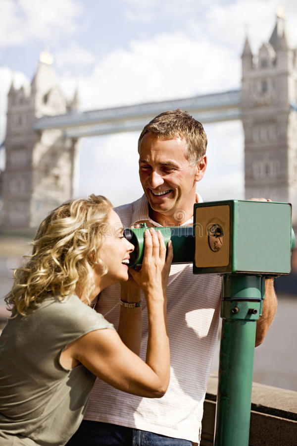 Download A Middle-aged Couple Using A Telescope, Laughing Stock Photo - Image: 67259240