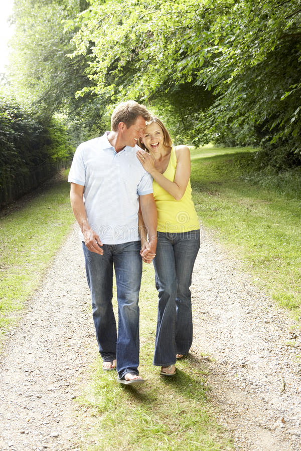 Middle aged couple walking in countryside royalty free stock photo