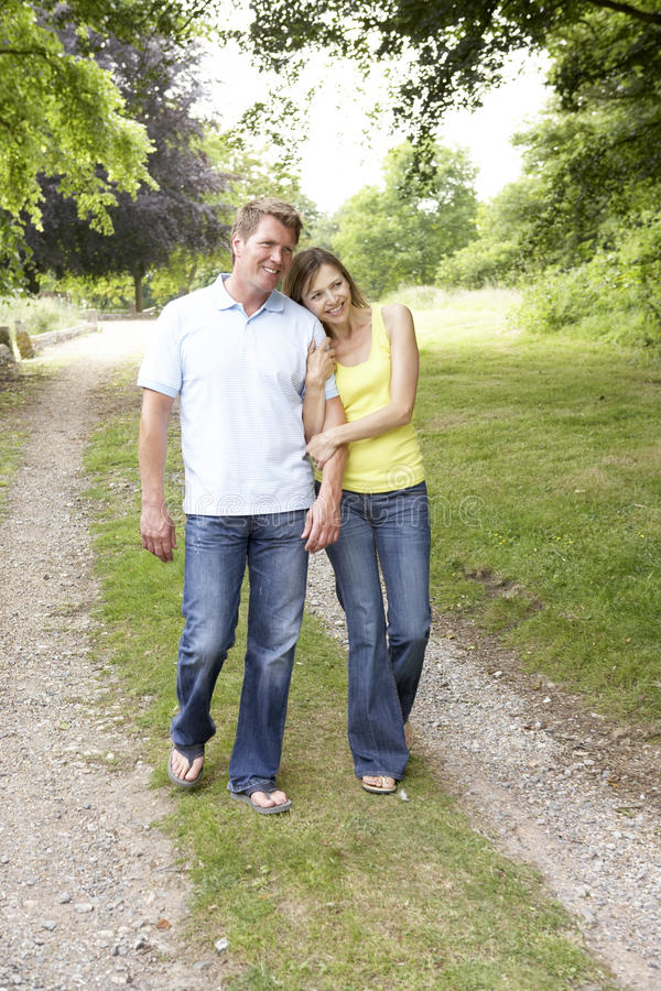 Middle aged couple walking in countryside stock image