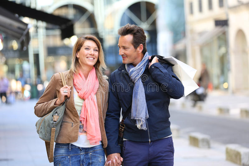 Middle-aged couple walking in the streets royalty free stock photography