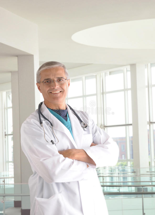 Middle Aged Doctor In Modern Medical Facility Royalty Free Stock Image