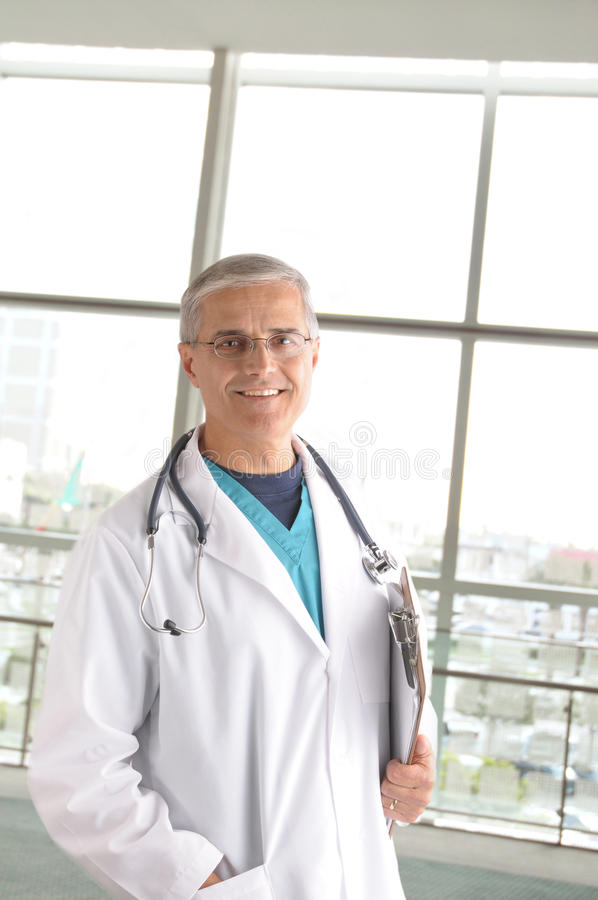 Download Middle Aged Doctor In Modern Medical Facility Stock Photo - Image: 12491012