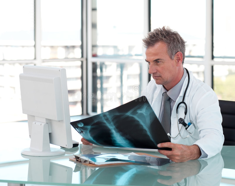Download Middle Aged Doctor Working At His Desk Stock Image - Image: 9166651