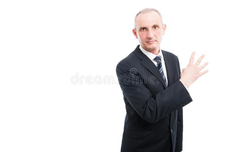 Middle aged elegant man showing number four gesture stock photography
