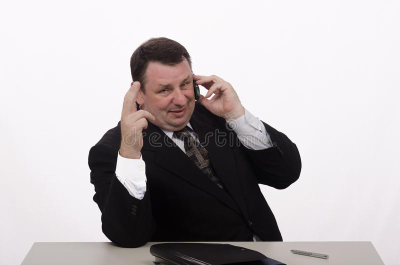 Middle aged employer talks on the phone stock photos