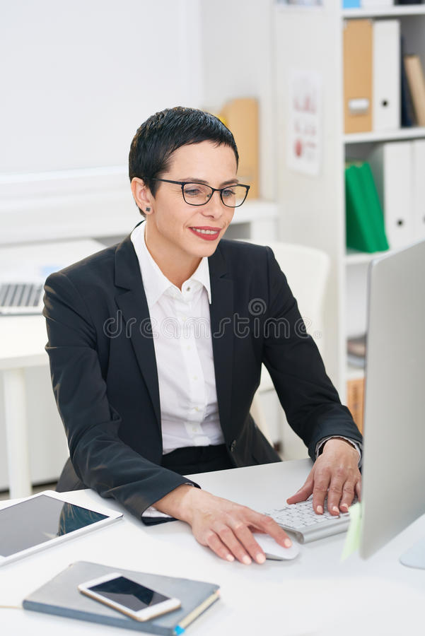 Middle-aged Entrepreneur Concentrated on Work stock image