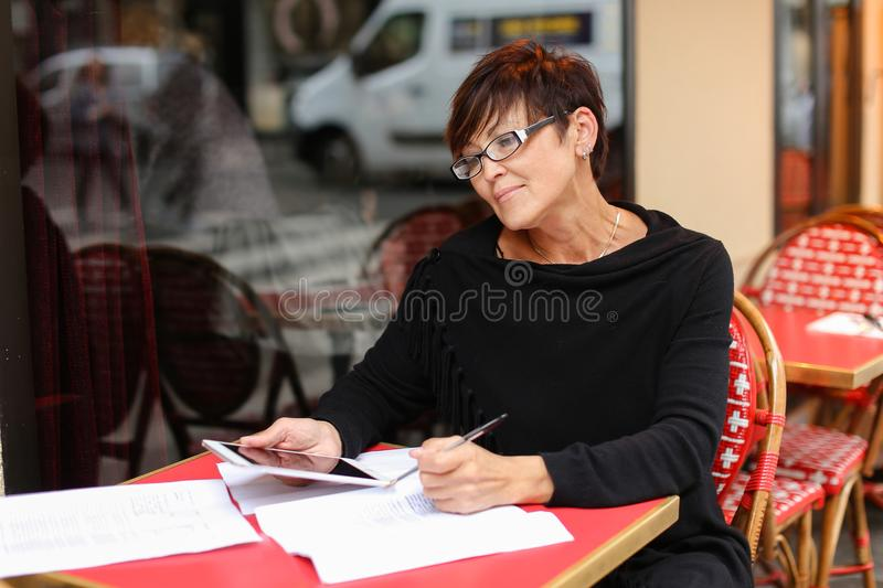 middle aged female designer use small tablet in profess royalty free stock photo
