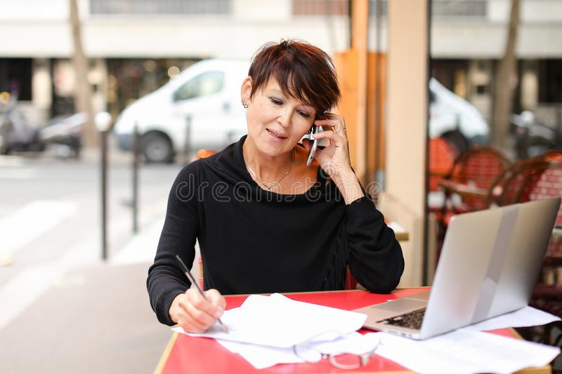 middle aged female extramural student using laptop for stock image