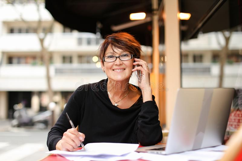 middle aged female extramural student using laptop for royalty free stock photography