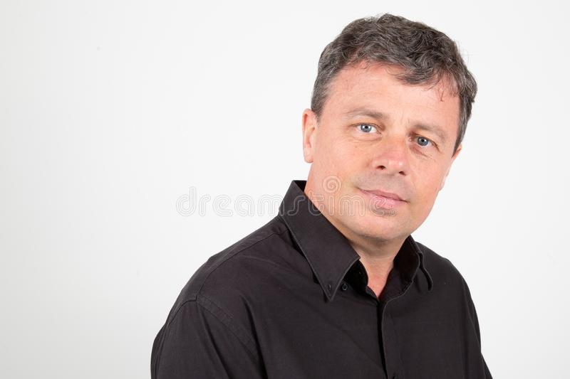 Middle-aged guy with black shirt in grey background stock image