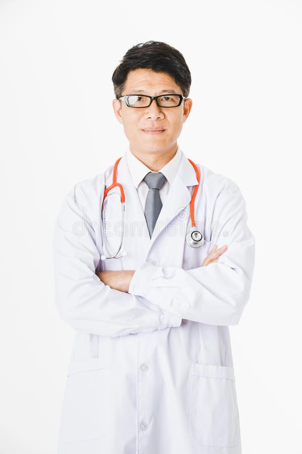 Asian doctor on isolated white. Middle aged, handsome, Asian, doctor, on duty at hospital stethoscope around his neck, proudly posing arms crossed with strong royalty free stock image
