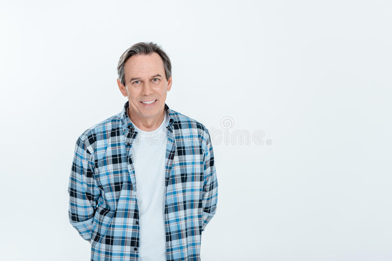 Middle aged handsome man smiling on white with copy space stock photos