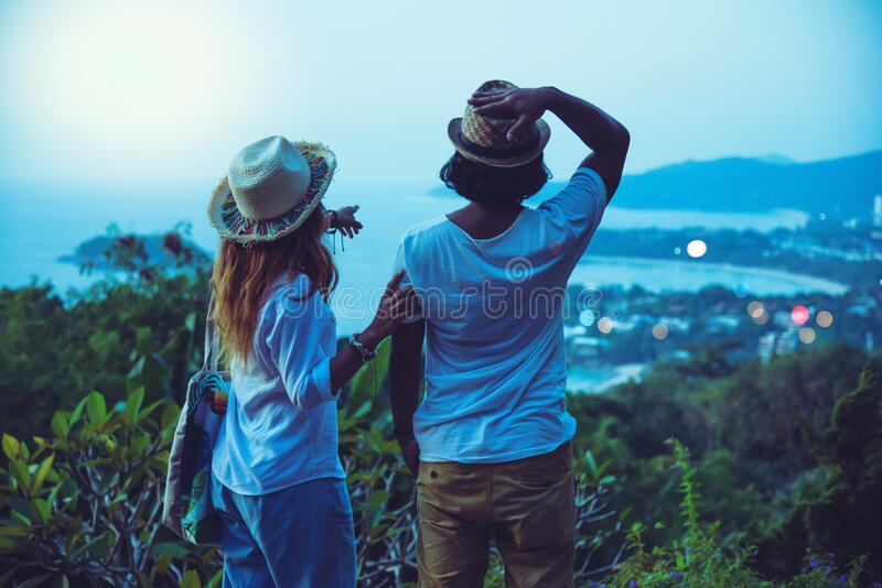 Middle aged Happy Romantic couple travel relax the beach in the holiday and standing watching the sunset. in summer royalty free stock photo