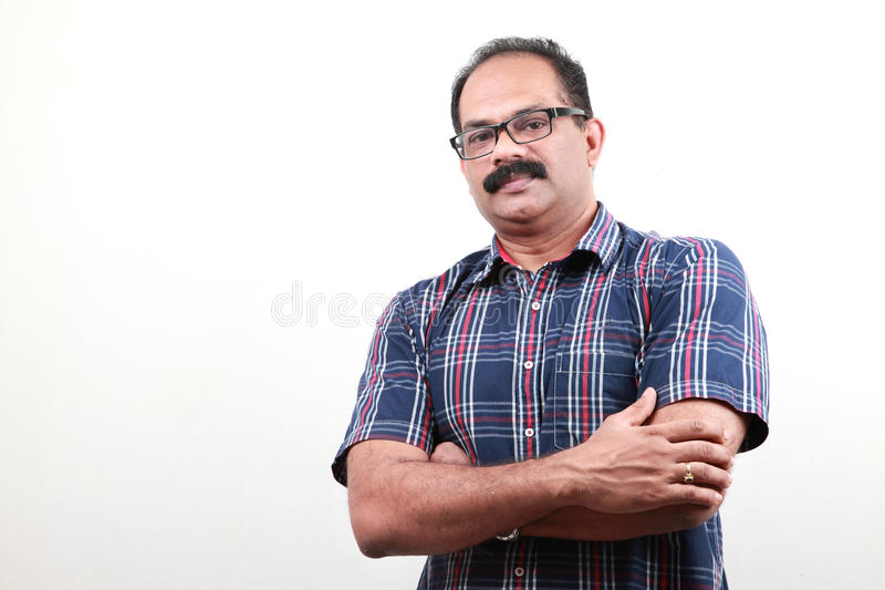 A middle aged Indian with folded hands stock images