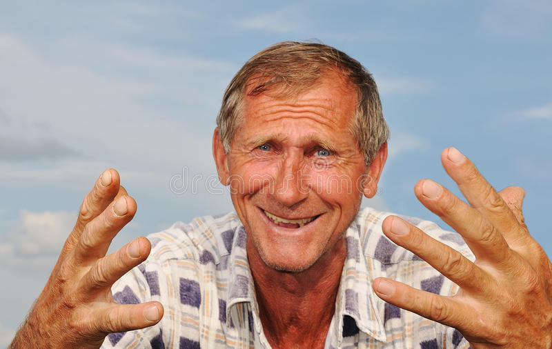 Middle aged male person with interesting gestures royalty free stock images