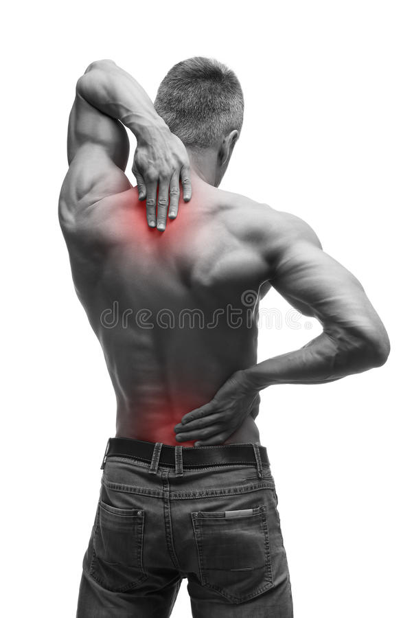 Middle aged man with back pain, muscular male body, studio isolated shot on white background with red dot stock image
