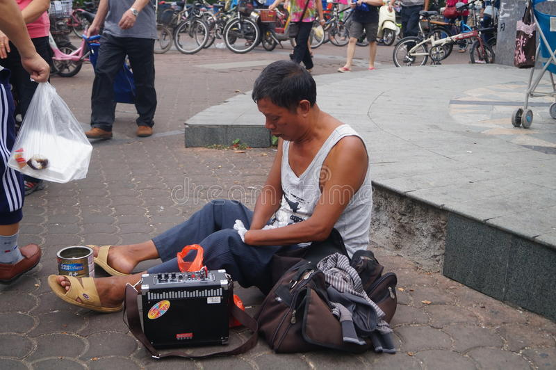 Middle-aged man begging in the streets. In Shenzhen, china stock photography