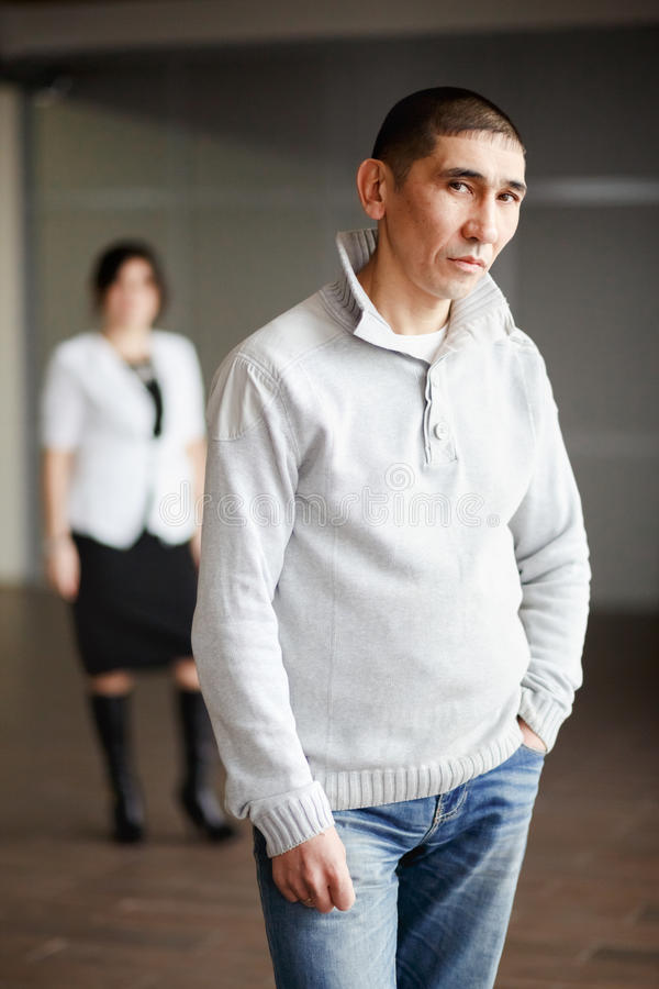 Middle aged man in casual clothes with short hair. A men in casual clothes with short hair thoughtfully looking directly into the camera, the employee gets a job royalty free stock photo