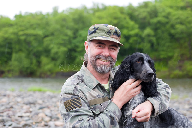 Middle aged man with a dog stock images
