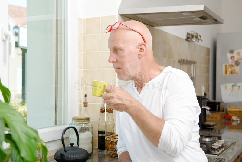 Middle-aged man drinking a cup of coffee stock photos