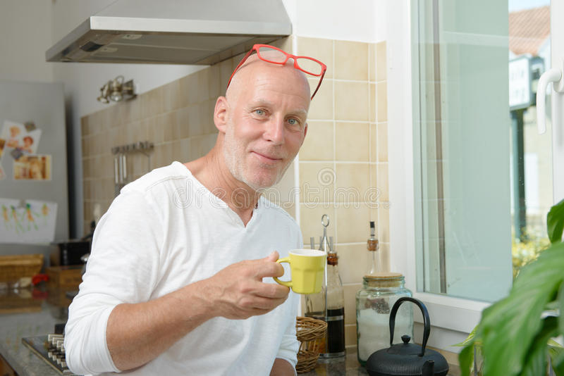 Middle-aged man drinking a cup of coffee stock image
