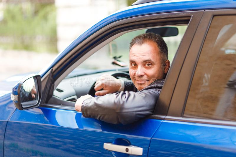 Middle-aged man driving a car royalty free stock image