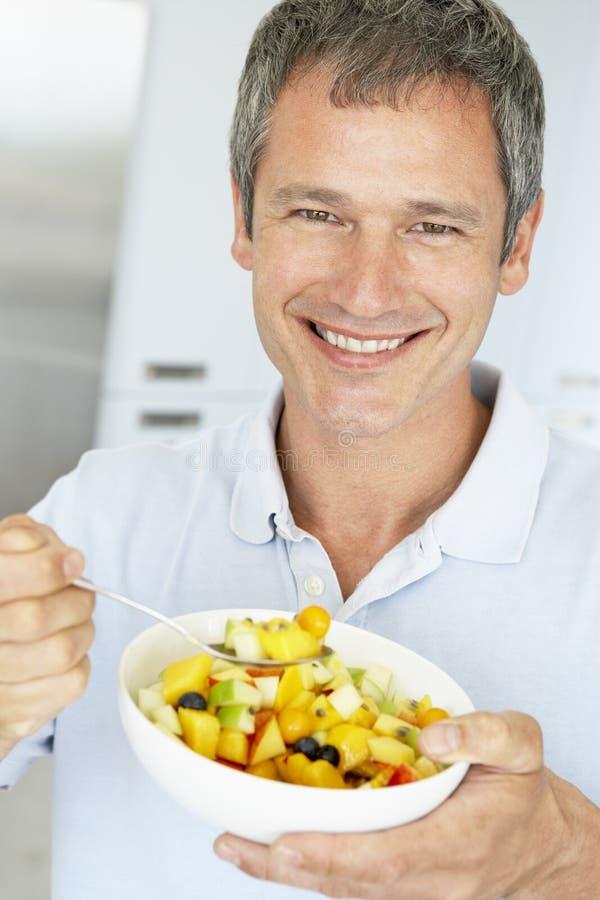 Middle Aged Man Eating Fresh Fruit Salad Stock Image