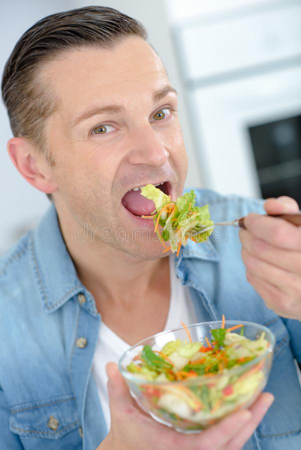 Middle aged man eating healthy meal. Middle aged man eating a healthy meal royalty free stock photo