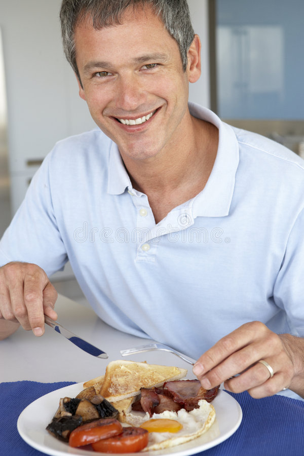 Middle Aged Man Eating Unhealthy Fried Breakfast royalty free stock photos
