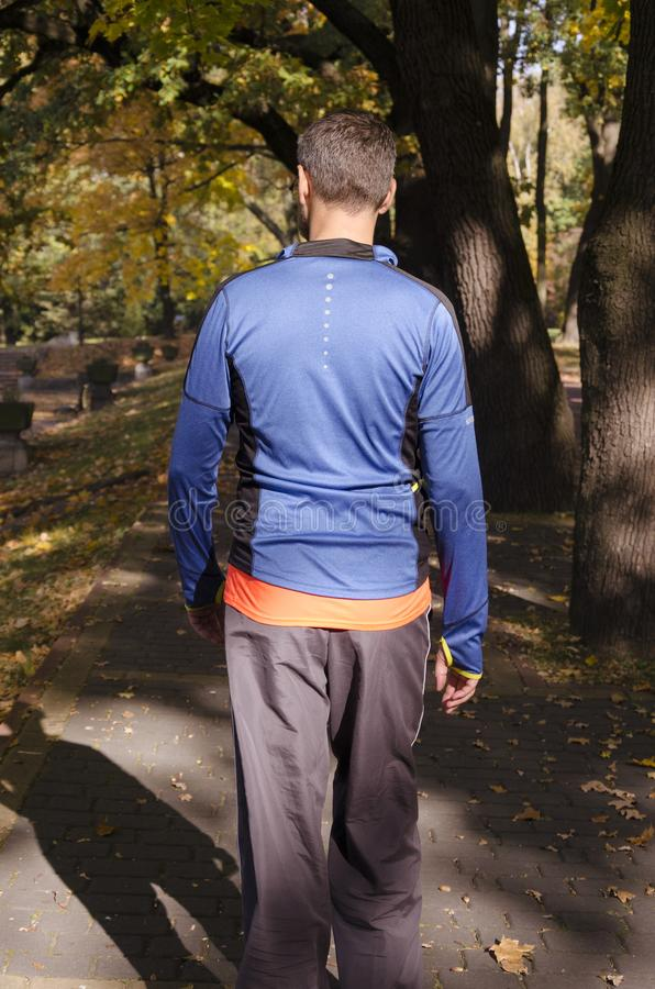A man in tracksuit during his workout in the park stock images