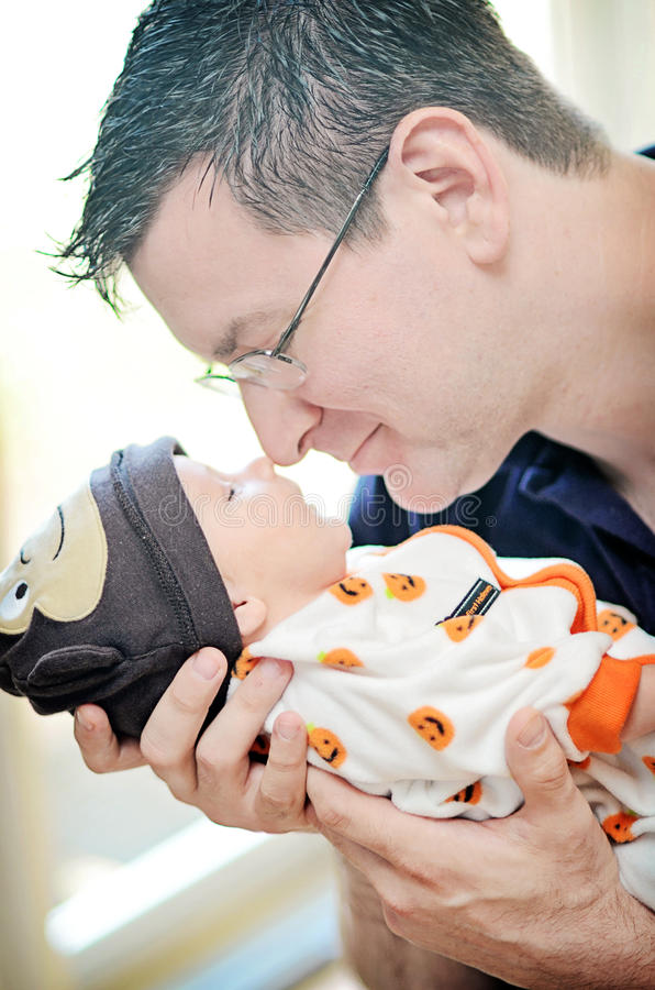 Free Middle Aged Man Holding Newborn Stock Photos - 53248573