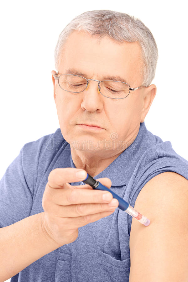 Download Middle Aged Man Injecting Insulin In His Arm Royalty Free Stock Photography - Image: 30993557