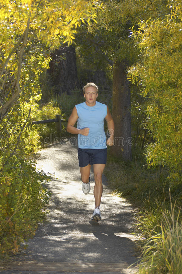 Middle Aged Man Jogging stock photography