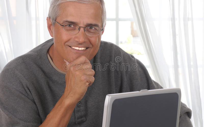 Download Middle Aged Man In Living Room With Computer Stock Image - Image: 14672907