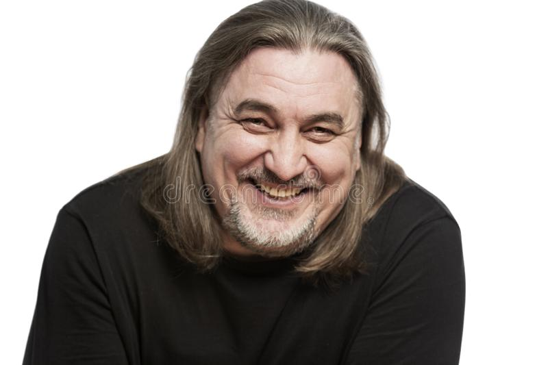 A middle-aged man with long hair laughs, close-up. Isolated on a white background royalty free stock images