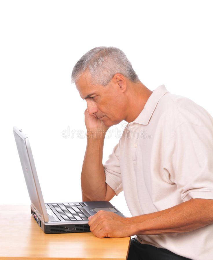 Download Middle Aged Man Looking Intently At Laptop Stock Photo - Image: 10514680