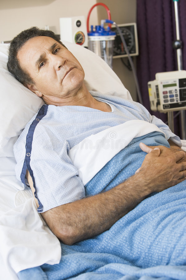 Middle Aged Man Lying In Hospital Bed royalty free stock photo