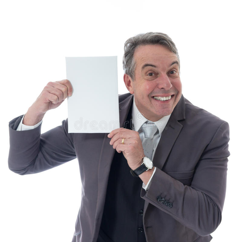 Middle-aged man puts a blank card next to his face. Executive in suit on white background. royalty free stock photos