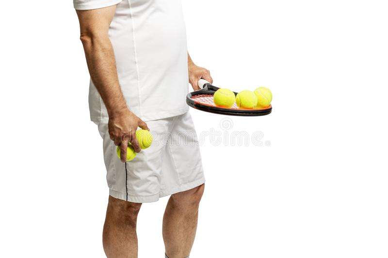 Middle aged man with racket and tennis balls. Isolated on a white background royalty free stock photo